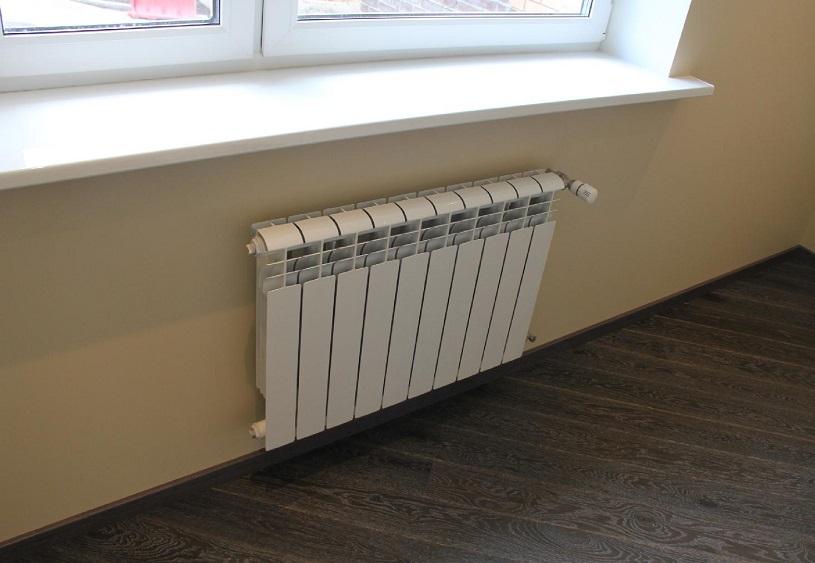 Почему радиаторы ставят под окнами